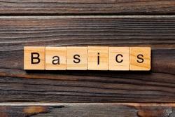 BASICS word written on wood block. BASICS text on table, concept.