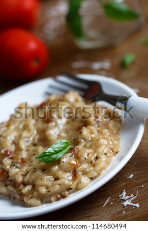 Basil and tomato risotto - stock photo