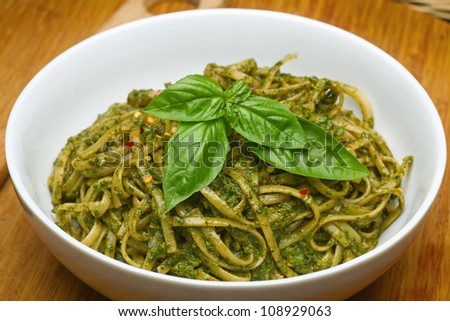 Basil Pesto over Linguine Pasta in White Bowl.