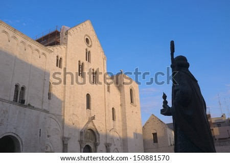 basilica and silhouette statue of St. Nicholas thaumaturge in old Town of Bari