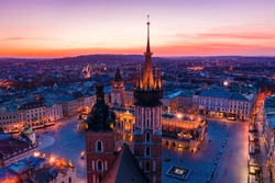 Basilica at Krakow old town city square at twilight drone view