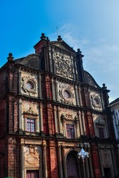 Basilica of bom jesus church in goa taken from lower angle with blue sky