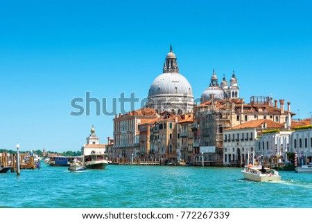 Basilica of Santa Maria della Salute on the Grand Canal in Venice, Italy. Grand Canal is one of main travel attractions of Venice. Historical buildings and landscape of Venice. Water trip in Venice. #772267339