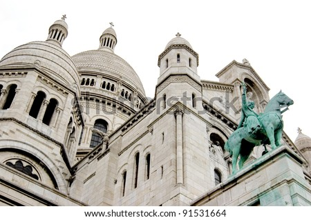 Basilica Sacre Coeur with monument, Paris