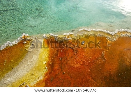 Basin Thumb Photo Background. Colors of Yellowstone. Horizontal Reddish and Blueish Colors. Nature Photo Backgrounds Collection. - stock photo