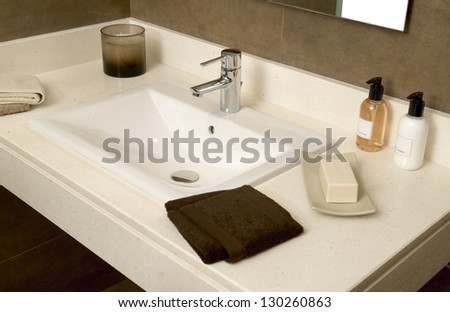 Basin with soap and towels in a bathroom