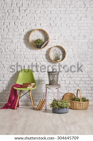 basket and brick wall decor with round frame