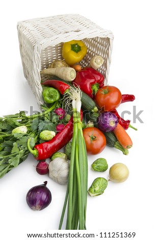 basket and scattered vegetables isolated on white with CLIPPING PATH