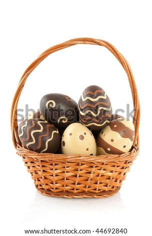 Basket filled chocolate easter eggs isolated over white