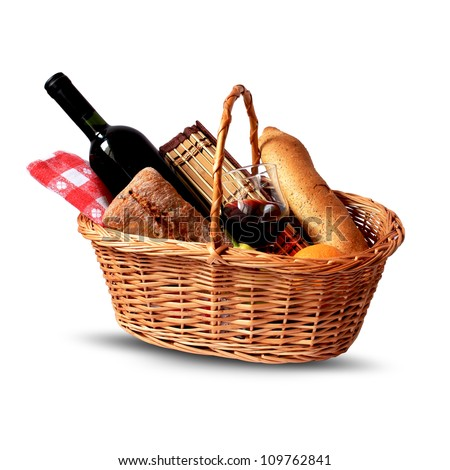 basket for picnic with wine, bread, fruits and picnic blanket