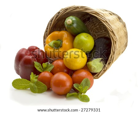 Basket from which vegetables  pepper, eggplant and tomatoes