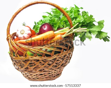 basket full of carrot cucumbers tomatoes celery red onion and garlic