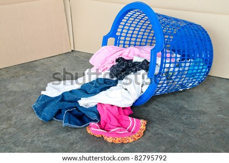 Basket full of dirty laundry. Concept of daily household chores.