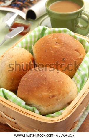 Basket full of fresh baked dinner rolls. - stock photo
