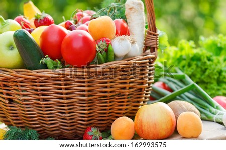 Basket full of fresh organic fruits and vegetables
