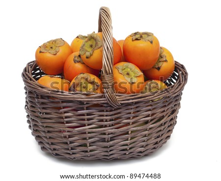 basket full of persimmons isolated on white background