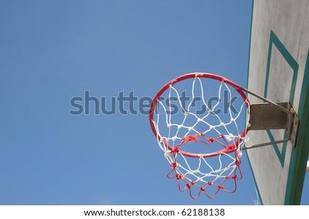 Basket hoop over sky - stock photo