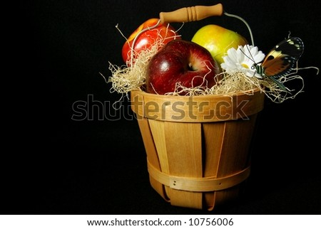 basket of apples with butterfly