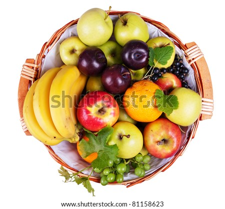 Basket of assorted fresh fruit, overhead view, isolated on white - stock photo