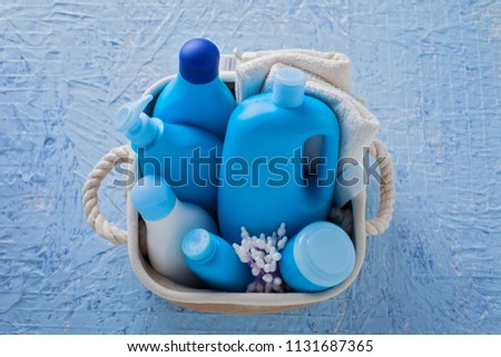 basket of baby cosmetics on blue background - baby time