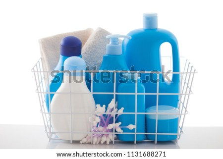 basket of baby cosmetics on white background - baby time