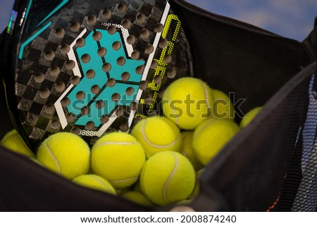 Basket of balls on a tennis or padle court Stock fotó ©
