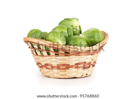 basket of brussels sprouts isolated on white background