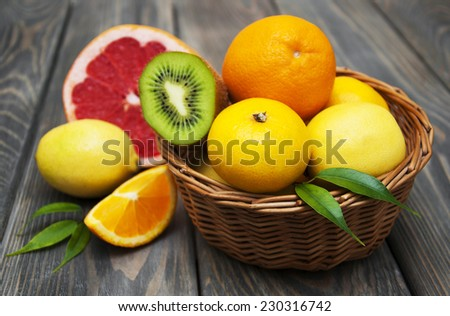 Basket  of Citrus Fruits on a wooden background #230316742