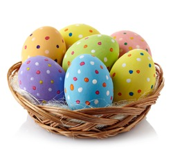 Basket of colorful Easter eggs isolated on white background