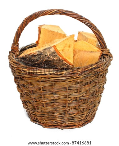 Basket of cut logs fire wood from Silver Birch tree (Betula pendula). Renewable resource of a energy. Environmental concept.