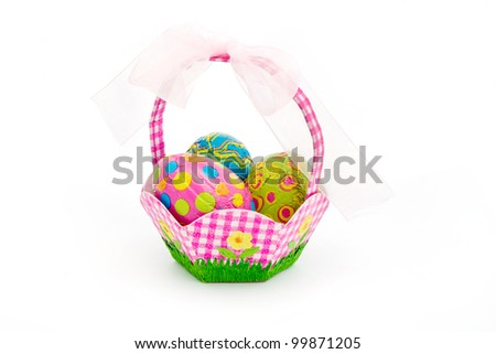 Basket of easter eggs on a white background