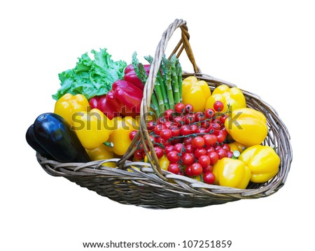 basket of fresh vegetables on a white background