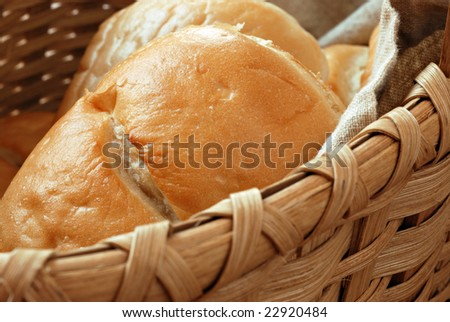 Basket of freshly baked dinner rolls.  Macro with extremely shallow dof.  Focus on the bread.