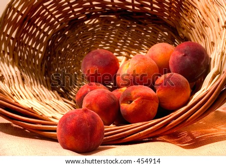 basket of golden peaches