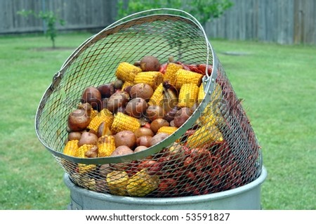 Basket Of Hot Boiled Crawfish With Corn, Sausage And Potatoes
