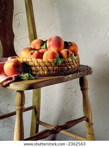 Basket of peaches on an old chair
