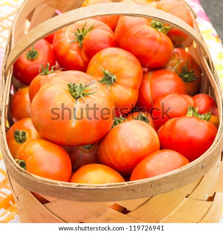Basket of red ripe tomatoes on display at the market