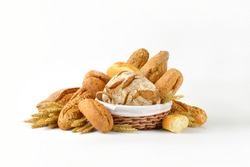 basket of various breads on white background