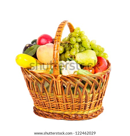Basket of vegetables and fruits isolated on white