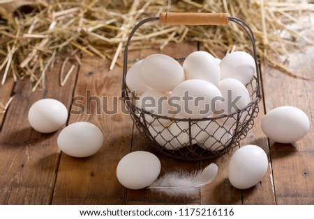 basket of white eggs on wooden table Сток-фото ©
