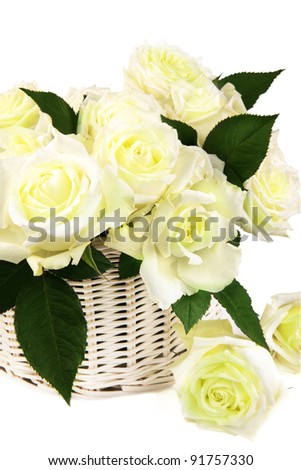 basket of white roses in vintage style