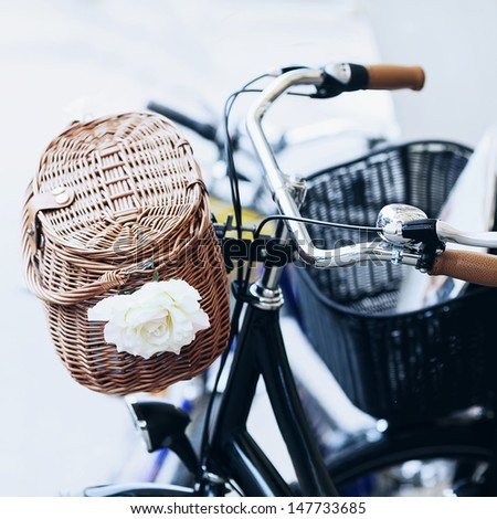 Basket on an old bike and a flower