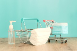 Basket or shopping cart with protective mask. Maintaining safe purchase during the COVID 19 epidemic