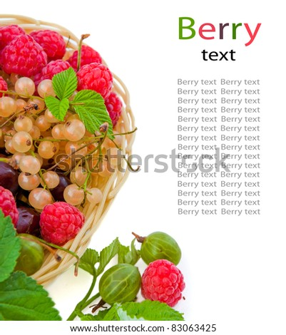 Basket with a raspberry, a cherry and a gooseberry, green leaves