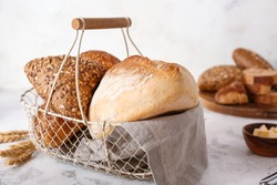 Basket with assortment of bread on table