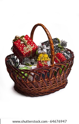 Basket with Colour gift boxes  isolated on white