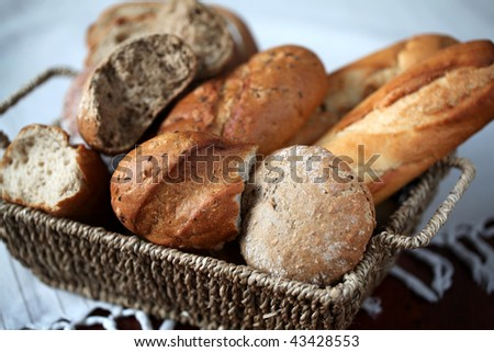 Basket with different kinds of fresh bread