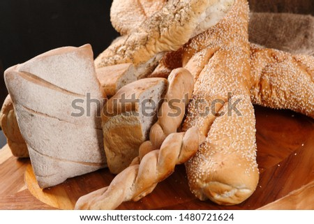 Basket with different types of traditional and artisan bread.