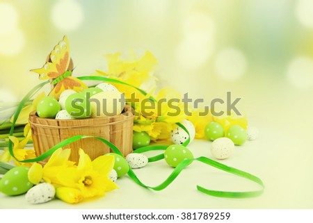Basket with easter eggs. #381789259