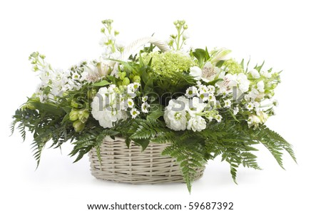 Basket with flowers. Isolated on white